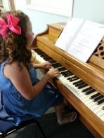 Geneva Kendall taking piano