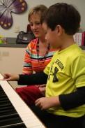 Geneva Vincent Taking Piano Lesson